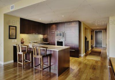 Wooden cupboards in modern kitchen
