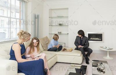 Caucasian family relaxing in living room