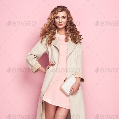 Young woman in white spring coat