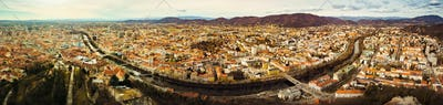 Aerial panorama view from Graz hill Schlossberg in Austria, cityscape with house roofs, mur river