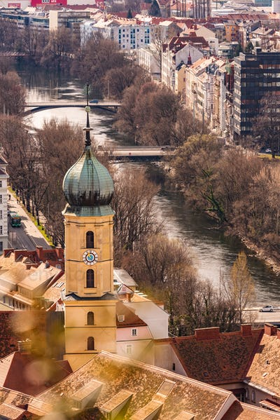 View at Graz city with his famous buildings. River mur. Vertical photo