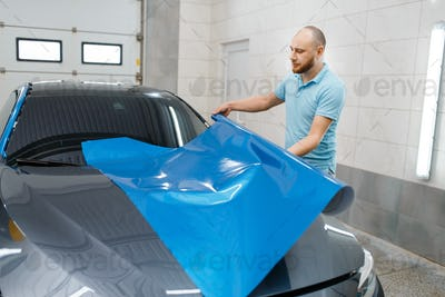 Car wrapper holds protective foil or film roll