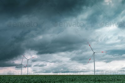 Green energy concept with wind turbines in field