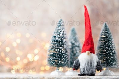 Christmas greeting card. Gnome festive background. New year symbol.