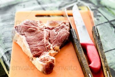 Raw Florentine beef steak on a cutting board