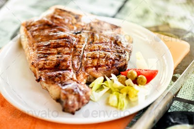 Grilled or barbecued Florentine steak on a plate