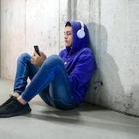 Young teenage boy chatting on his mobile phone