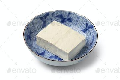Piece of fresh regular tofu in a Japanese bowl