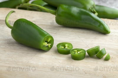Fresh green jalapeno peppers and slices