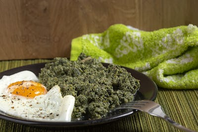 Nettles stew with a fried egg