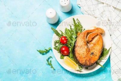 Salmon fish with fresh salad