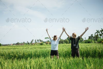 Couple pose in the middle of the rice field
