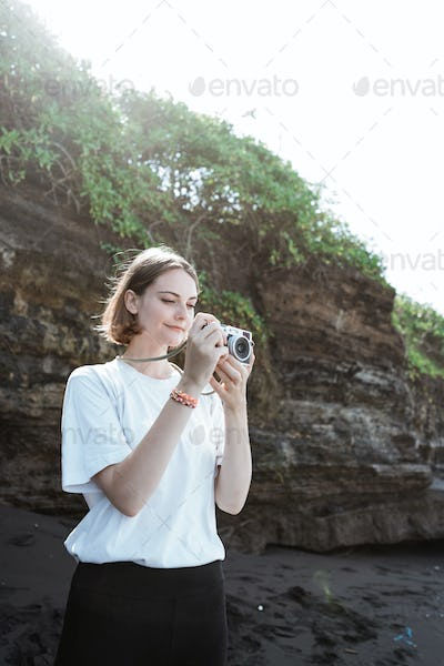 Female photographer taking photo with her camera