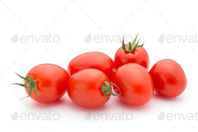 Small plum tomatoes on a white background.