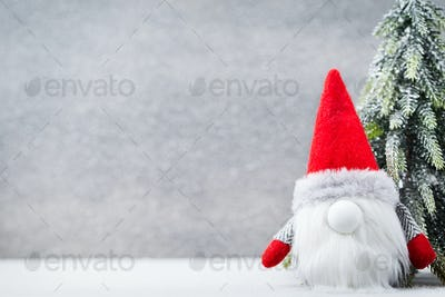 Christmas gnome und santa hat. Christmas pattern. Background on the gray color.