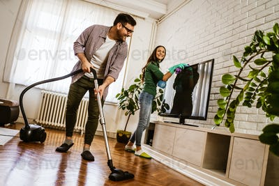 Couple cleaning their home