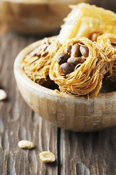 Traditional arabic dessert Kunafa with honey