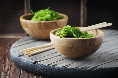 Traditional Japanese chuka salad on the wooden table