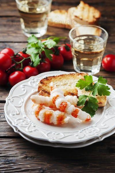 Italian antipasto with shripms and white wine