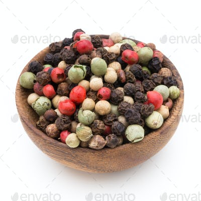 Pepper mix seed on spoon on white background.