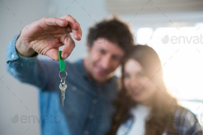 Couple holding the key of new home