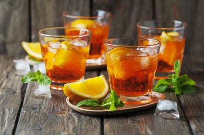 Glass of aperol with ice, orange and mint