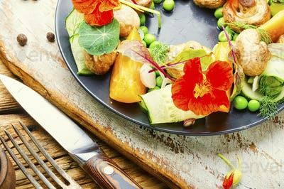 Summer vegetable salad with flowers.