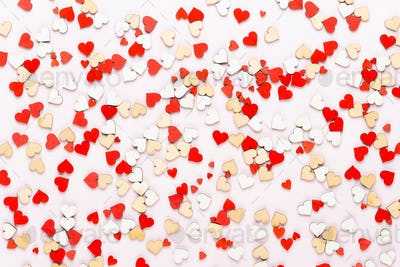 Happy Valentines day background. With small color hearts on gray background.