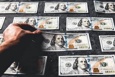 One hundred dollar bills are creatively laid out. Business concept, development perspective