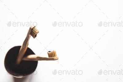 Wooden bamboo toothbrushes on white background isolated. The concept of zero waste, recycling