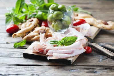 Italian antipasto with chicken ham and bread