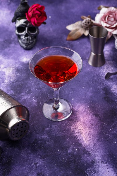 Halloween martini cocktail on purple background