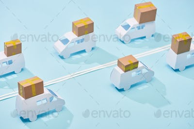 Closed Cardboard Parcels on White Mini Vans on Blue Background With Double Line
