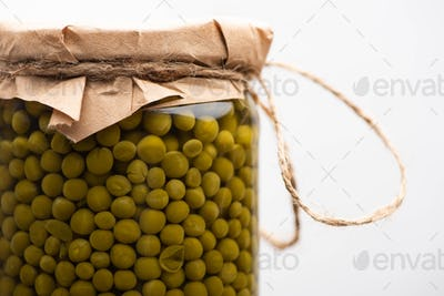 Close up View of Homemade Tasty Canned Green Peas in Jar Isolated on White