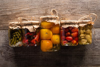 Top View of Delicious Homemade Tasty Pickles on Wooden Rustic Table