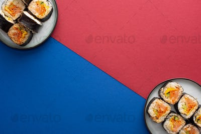 Top View of Plates With Gimbap on Crimson And Blue