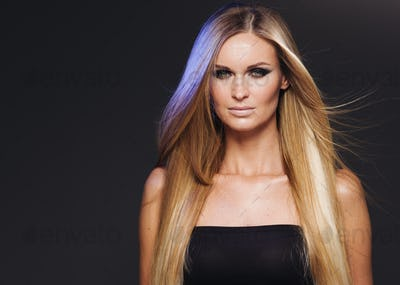 Smoky blonde woman smooth long hair beauty makeup. Portrait view.