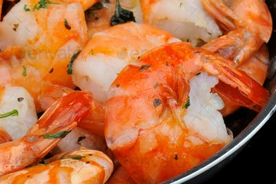 Cooking shrimp on a pan. Close up view.