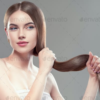 Long hair woman hand touching hair smooth brunette hairstyle model