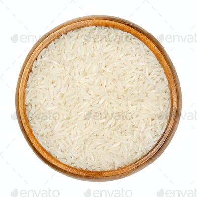 White Basmati rice, aromatic long grain rice in wooden bowl