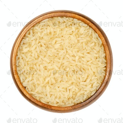 Parboiled long grain rice, converted rice in wooden bowl