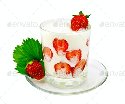 Yogurt thick with strawberries in glass on saucer