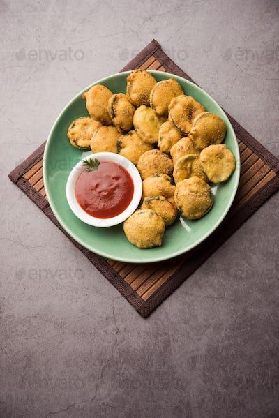 Gilki Pakora /pakoda / Bhajji also known as Sponge Gourd Fritters, served with tomato ketchup