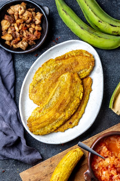 COLOMBIAN CARIBBEAN CENTRAL AMERICAN FOOD. Patacon or toston, fried and flattened whole green
