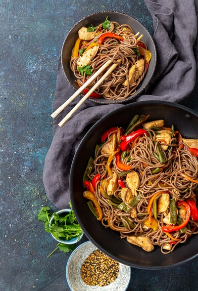 Japanese dish buckwheat soba noodles with chicken and vegetables carrot, bell pepper