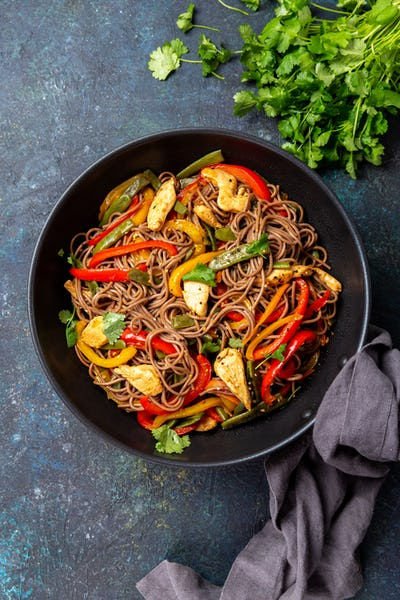 Japanese dish buckwheat soba noodles with chicken and vegetables carrot, bell pepper and green beans