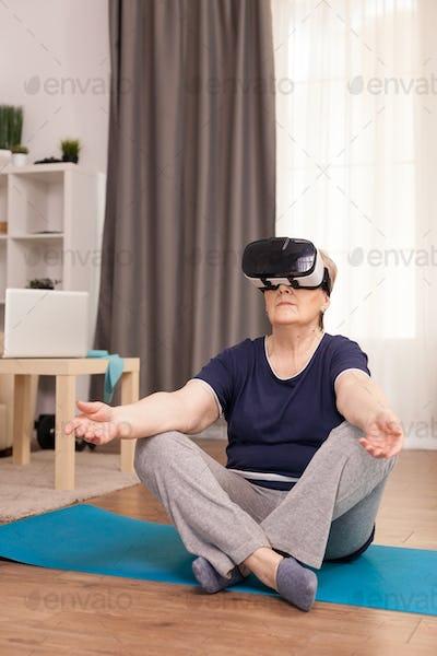 Senior woman using VR headset