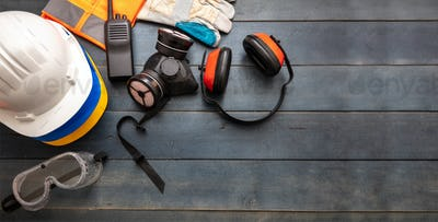 Work safety protection equipment. flat lay on wooden background.