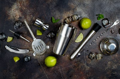 Bartender tools, lime, mint and ice