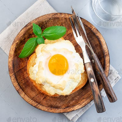 Trendy cloud or fluffy egg dish on  wooden plate, top view, square format